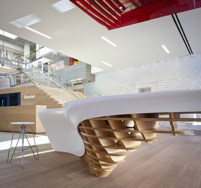 Office with a perfect combination of a composite material, white shiny surface and the natural wood