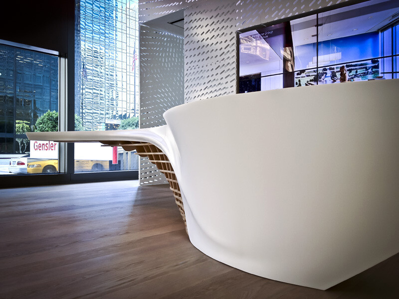 Office with a perfect combination of a white shiny surface and the natural wood
