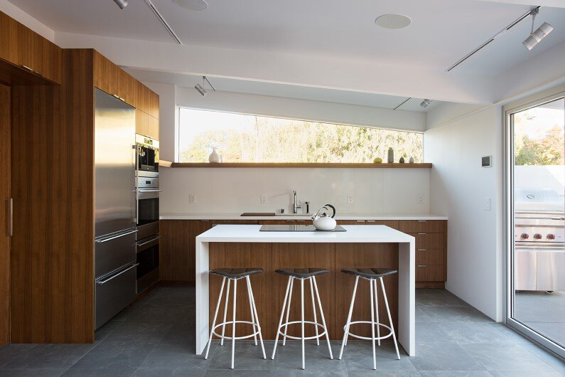 Kitchen- renovated single-family house by Klopf Architecture