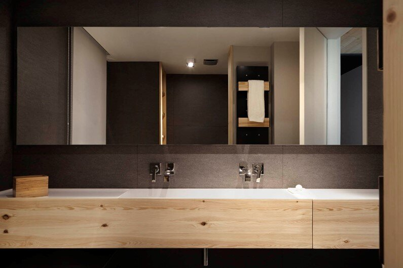 Family house with wooden interior that gives freshness- bathroom