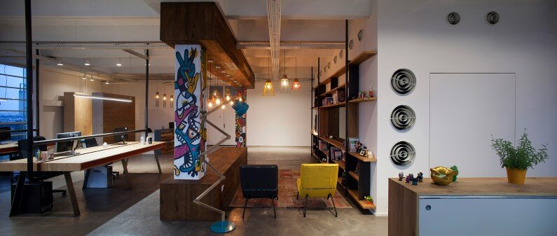 Industrial style workspace by architect Roy David