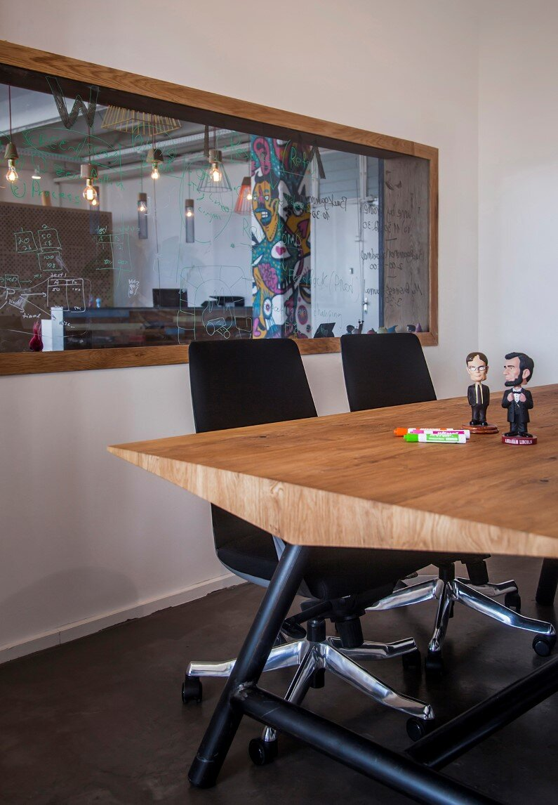 Industrial style workspace designed by architect Roy David - Jelly Button Games and Hamutzim Studio