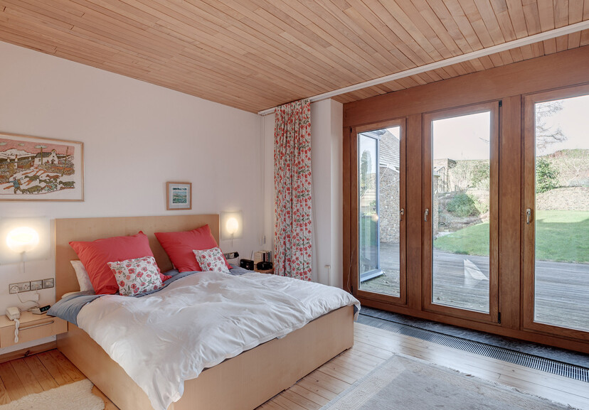 Traditional barn building with contemporary interiors - bedroom