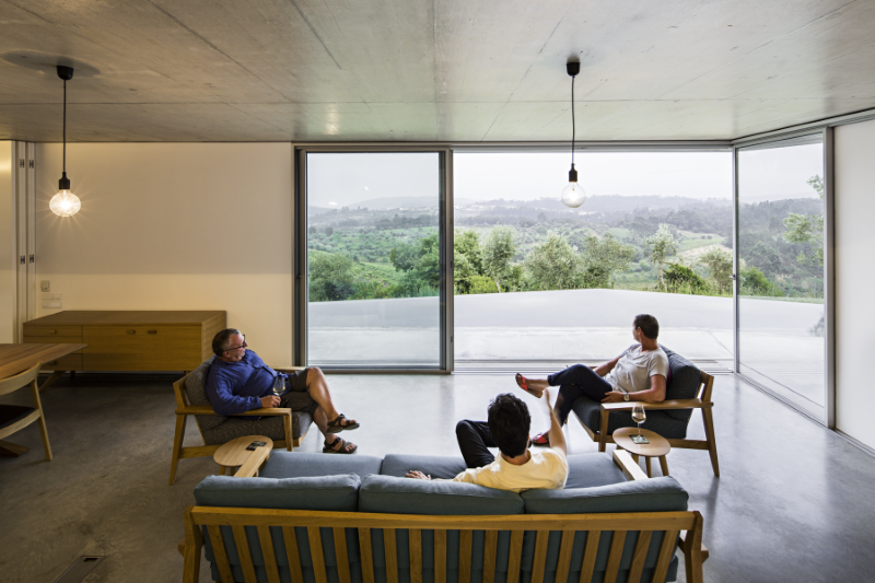 Gateira concrete house designed in harmony with dramatic landscape (16)