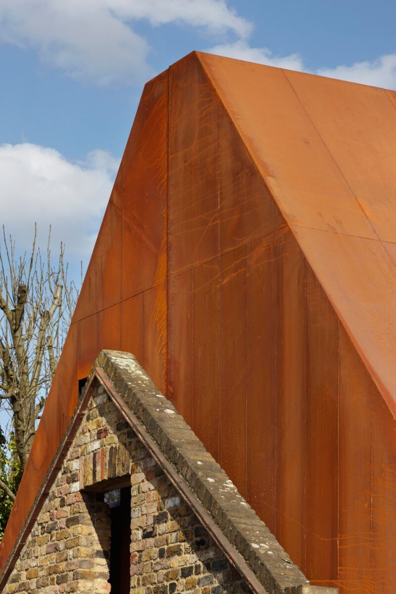 Kew House - family home formed of two sculptural volumes of weathering steel (4)