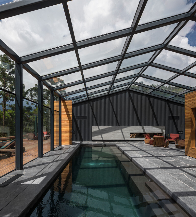 Metallic structure house in the midst of a beautiful forest of pine trees (6)