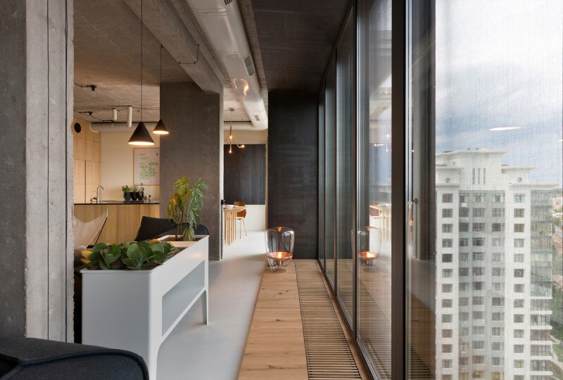 Penthouse with concrete ceiling and a glass-wall windows (10)