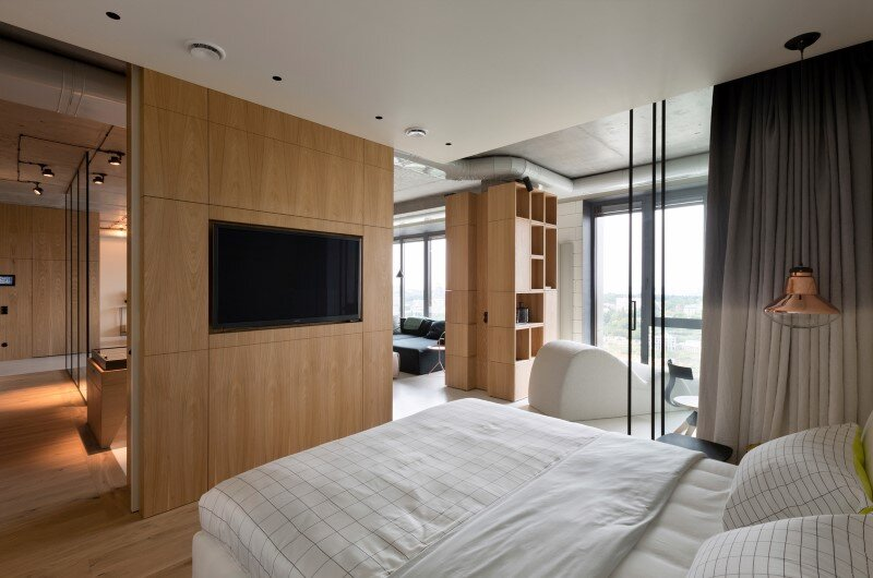 Penthouse with concrete partitions and ceiling and a glass-wall windows (14)