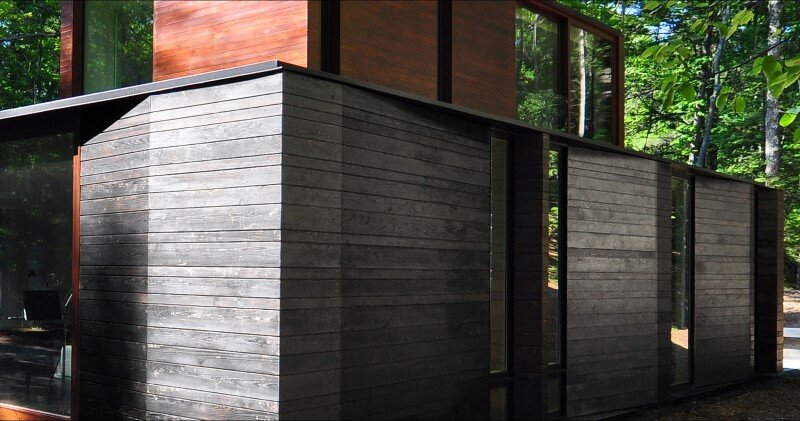 Pleated house - textured wood structure with a green roof (7)