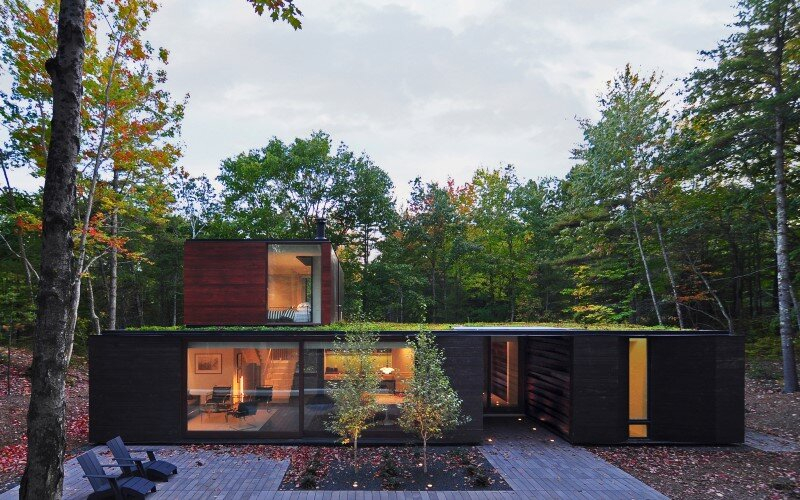 Sylvan Retreat textured wood structure with a green roof (1)