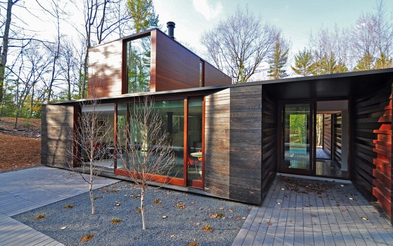 Sylvan Retreat textured wood structure with a green roof (9)