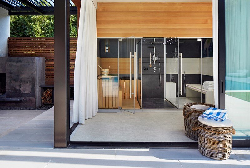 Lavish pool and spa retreat with a stunning wood and steel structure 8