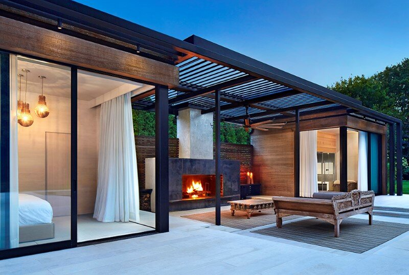 Lavish pool and spa retreat with a stunning wood and steel structure 9