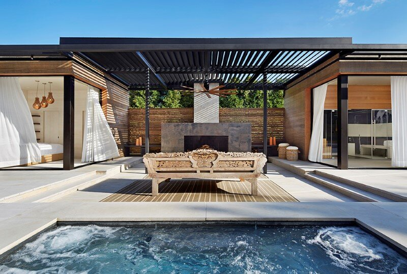 Lavish pool and spa retreat with a stunning wood and steel structure 3