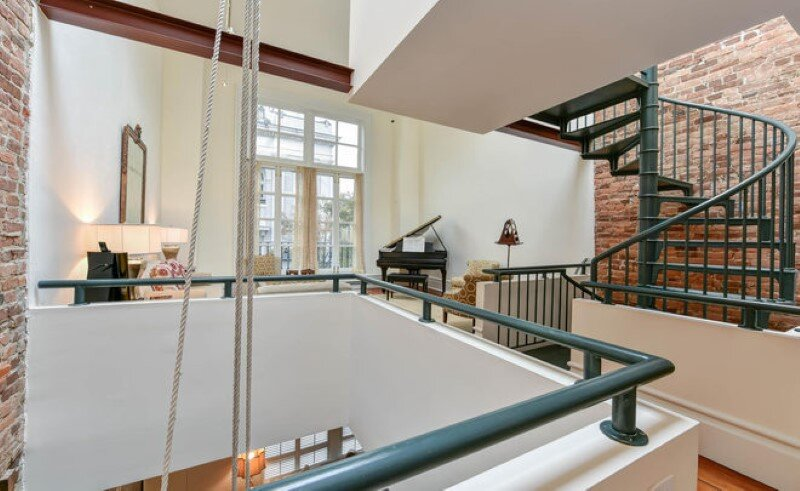 Renovated 1850s firehouse with preserving the original architectural elements (4)