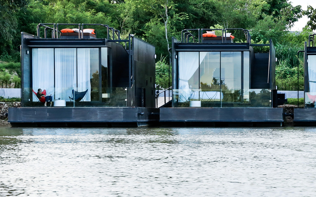 Agaligo Studio have designed - X-Float - a series of floating homes on the River Kwai Bridge, Thailand (1)