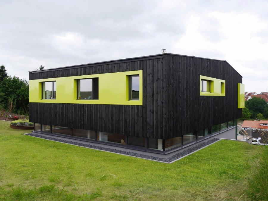 This German Family House is a Black Cuboid Supported by Glass Walls (2)