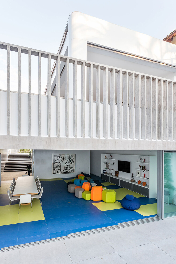 Toy House Was Conceived as a Huge Playground for a Growing Family (9)