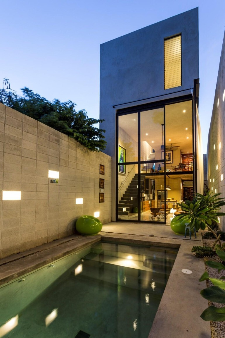 Raw House - Maximizing Vertical Space and Light on a Narrow Lot (1)