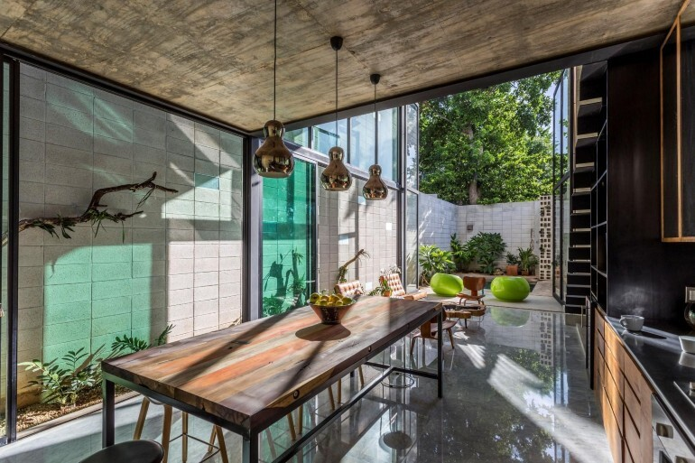 Raw House - Maximizing Vertical Space and Light on a Narrow Lot (10)