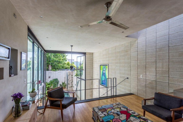 Raw House - Maximizing Vertical Space and Light on a Narrow Lot (11)