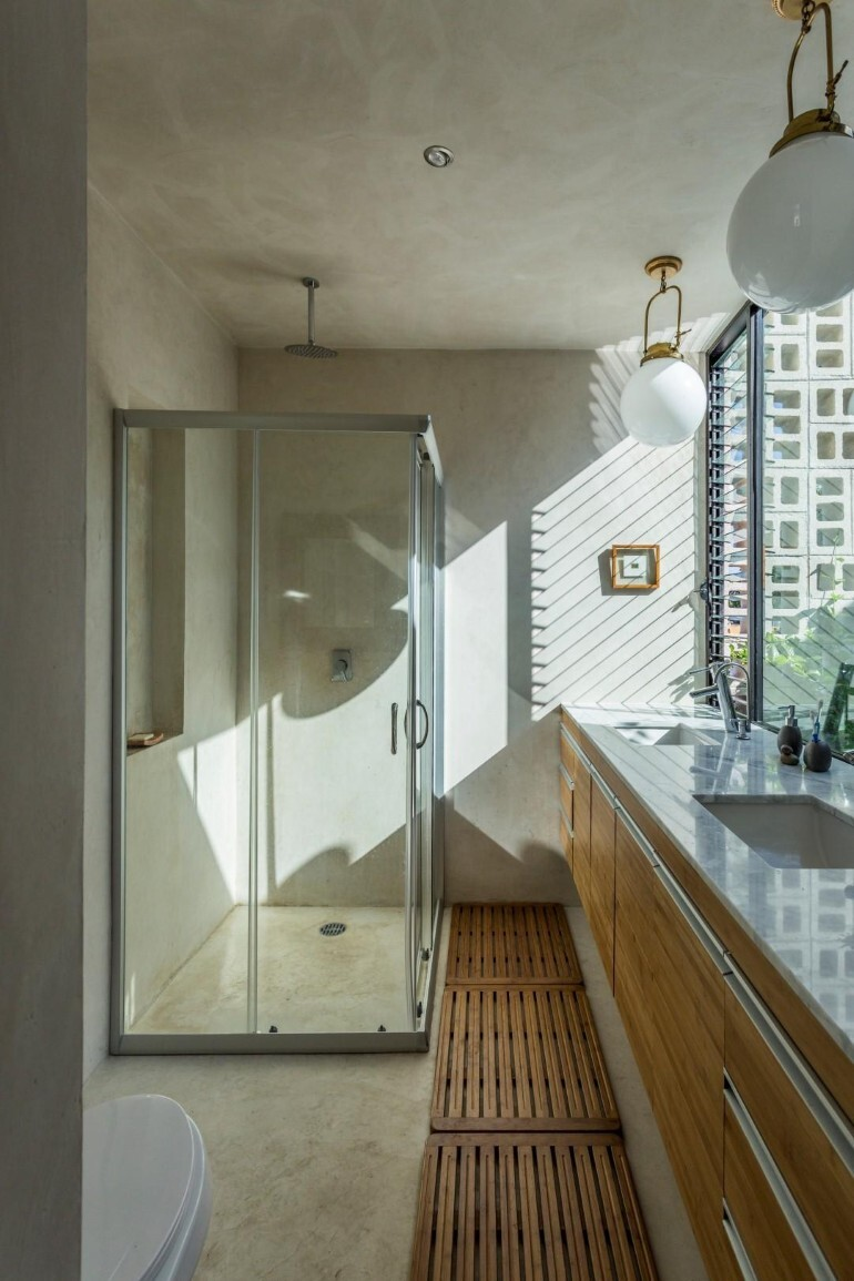 Raw House - Maximizing Vertical Space and Light on a Narrow Lot (14)