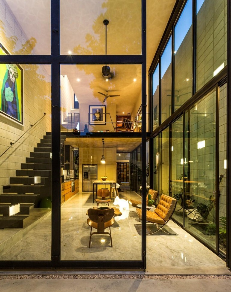 Raw House - Maximizing Vertical Space and Light on a Narrow Lot (20)