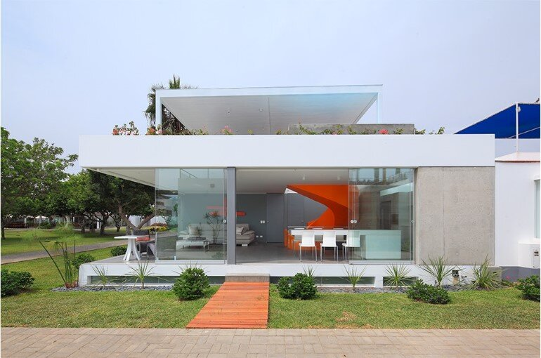 Casa Blanca Has a Striking Orange Staircase That Connects All Indoor Areas (2)