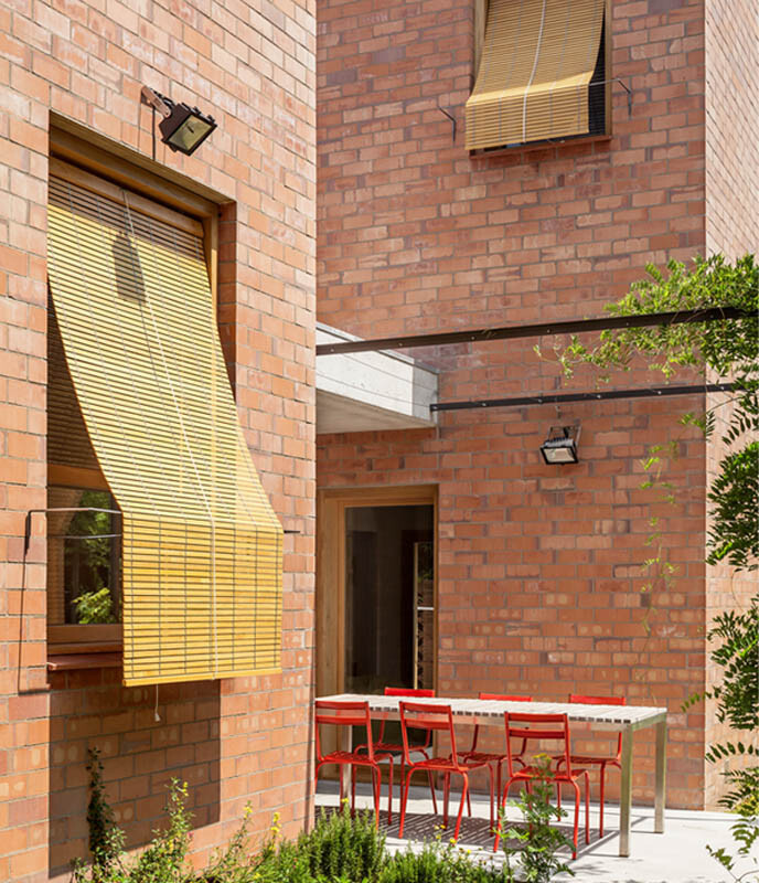 This Barcelona House Consists of Three Volumes Strongly Connected to a Garden (4)