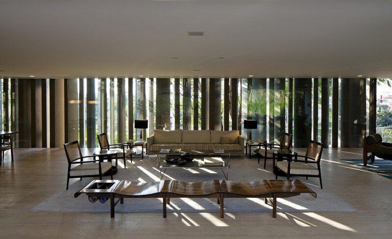 Social area view from outdoor covered space. Three-seat bench by