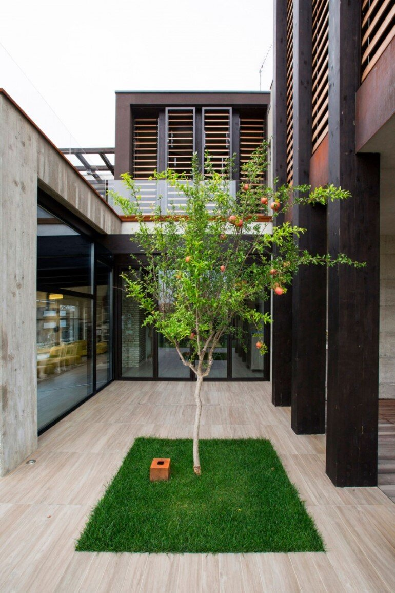 Modern Concrete Block House with Wooden Patio Attached (3)
