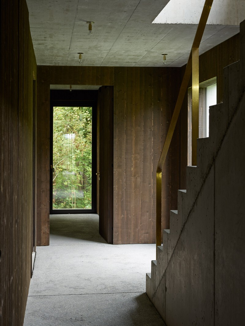 The Architecture of This Family House Combines Raw Concrete with Dark Wood (9)