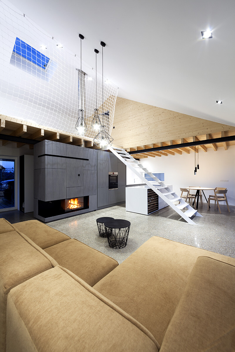 Under the Calvary House Has Traditional Shape and Modern Interiors (10)