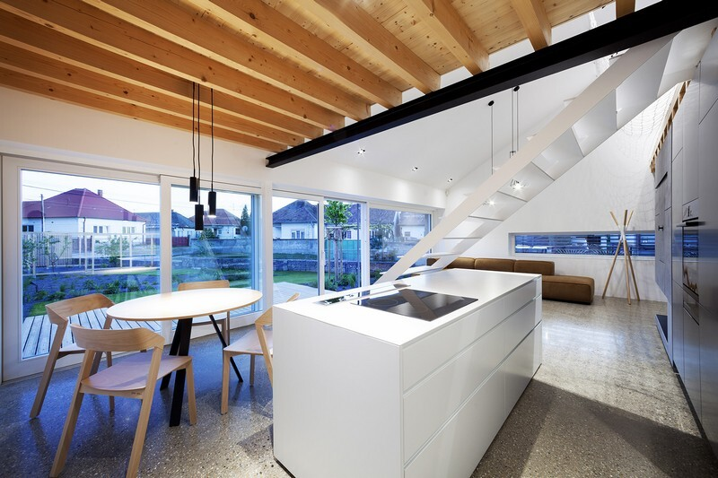Under the Calvary House Has Traditional Shape and Modern Interiors (5)