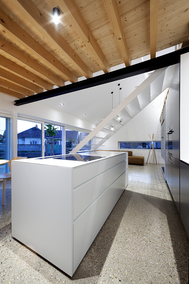 Under the Calvary House Has Traditional Shape and Modern Interiors (9)