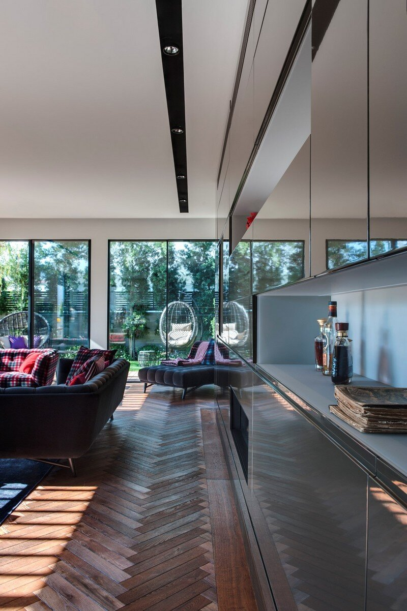 SH House - Modern Town House with a Mix of Design Motives 5