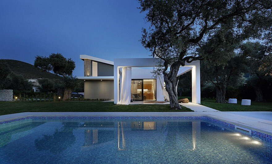 L-Shaped Villa Featuring Large Openings, Clean Surfaces and Bohemian Luxury 15