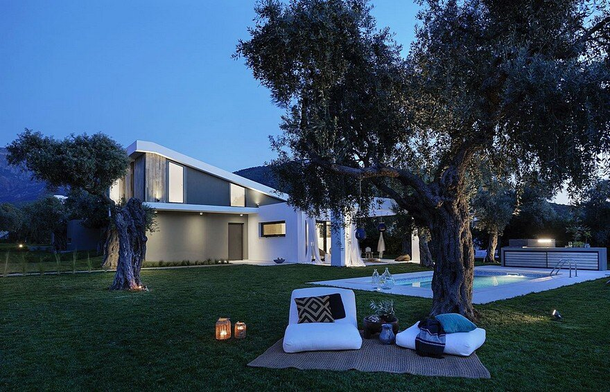 L-Shaped Villa Featuring Large Openings, Clean Surfaces and Bohemian Luxury 19