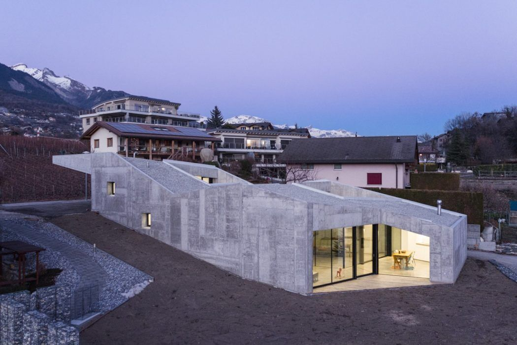 Massive Concrete Family House with Generous Inner Apertures to the Light