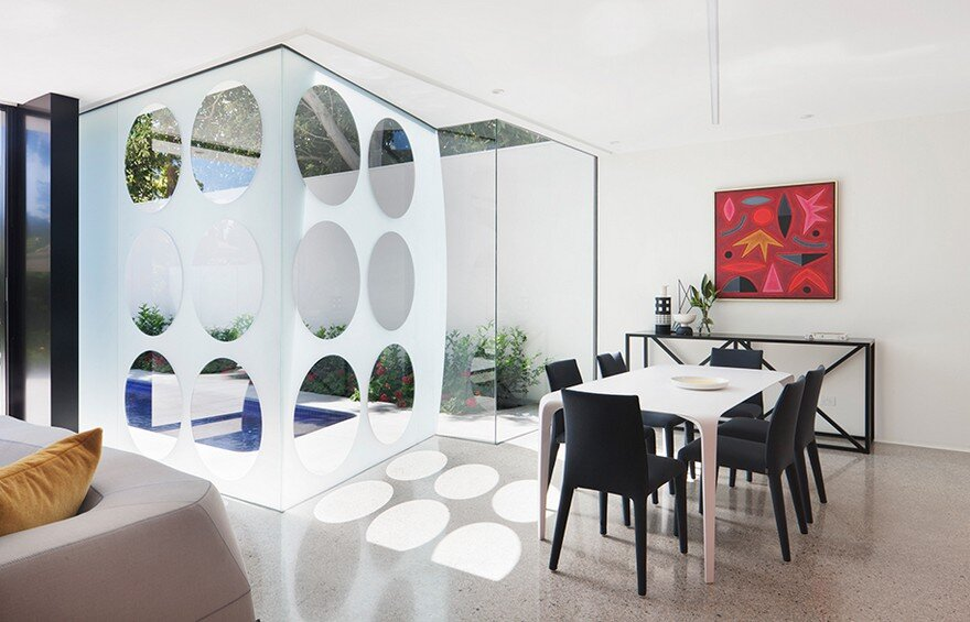Unconventional House With Elliptical-Shaped Walls That Create New Spatial Perspectives 8