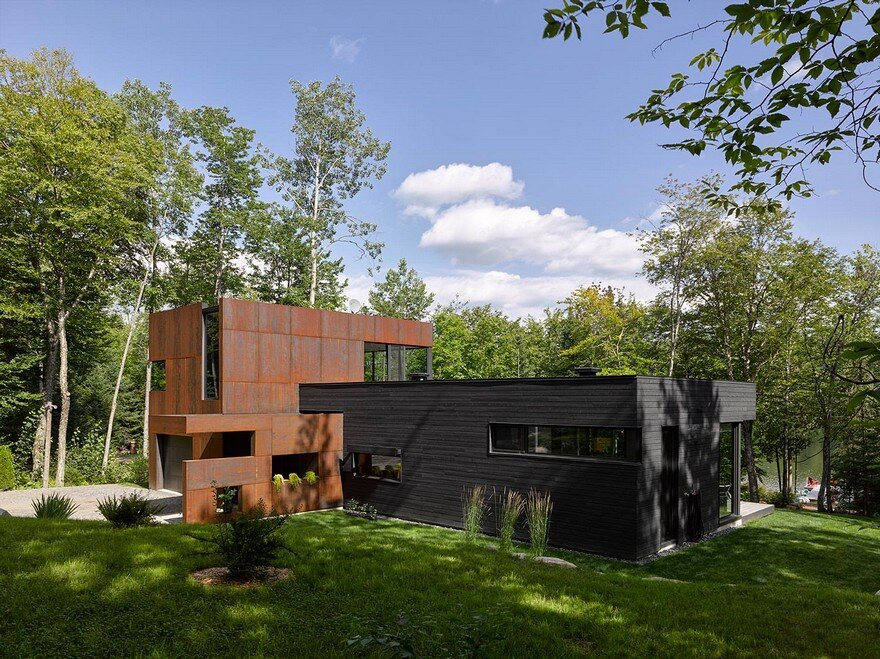 Contemporary Canadian Lake House Features Black Dyed Cedar and Rusted Metal Cladding 1