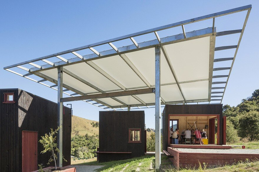 Ecosanctuary Welcome Shelter: Floating Roof Over the Wooden Boxes 4