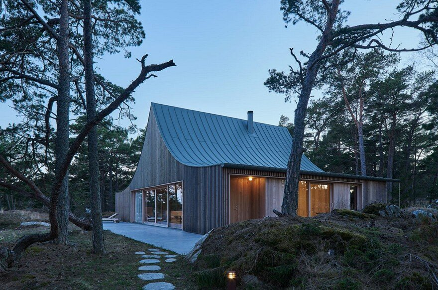 This Scandinavian Wooden House Has a Tent-Like Roof Over a Generous Interior Space 19