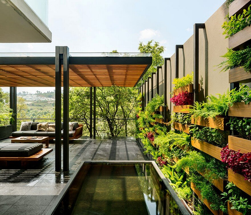Jardin Apartment Provides a Close Connection of Living Spaces with Patios and Interior Gardens 9
