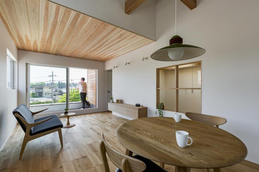 Box-Shaped Japanese Home with Warm Minimalist Interior Design 11