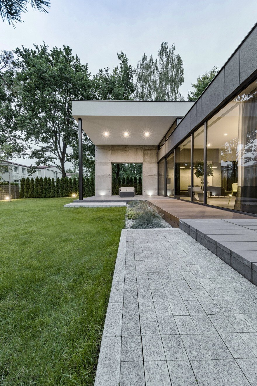 L Shaped Family Home Exhibiting A Distinctive Roof And Custom Interior
