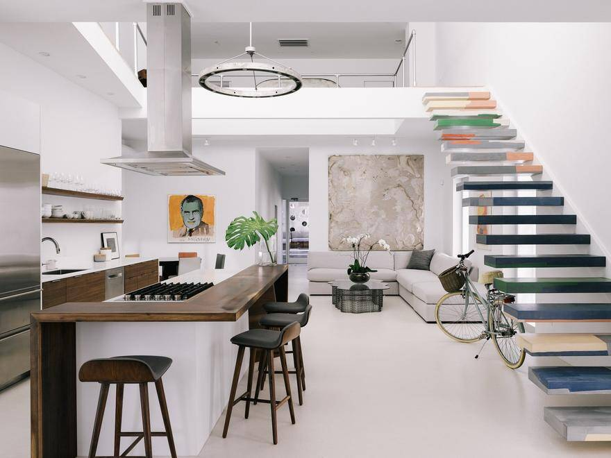 1950's Duplex Home Redesigned with a Focus on Natural Lighting and Interior / Exterior Transitions 4