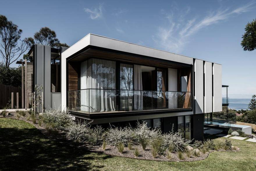 Two Angle House Featuring Provocative Architecture Using Concrete, Stone and Wood 1