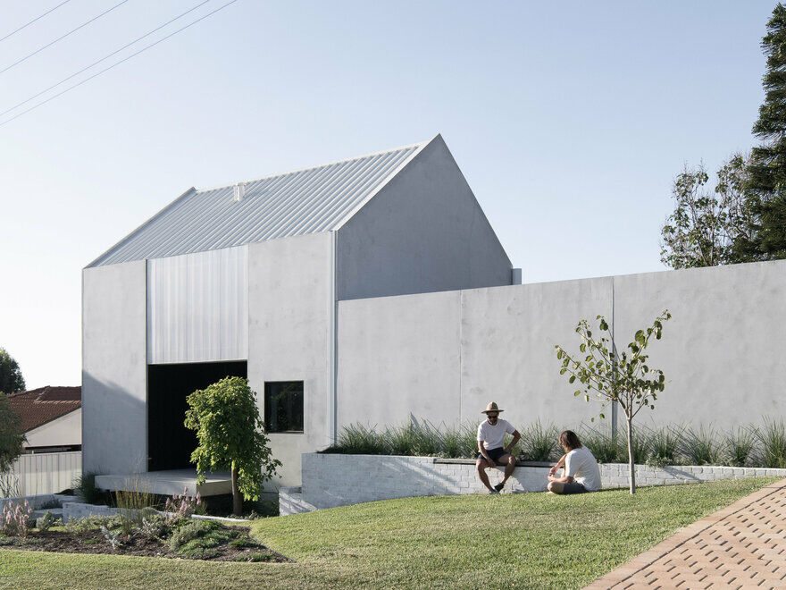 Carbon Neutral House Made from Concrete Panels and Whitewashed Recycled Brick 12