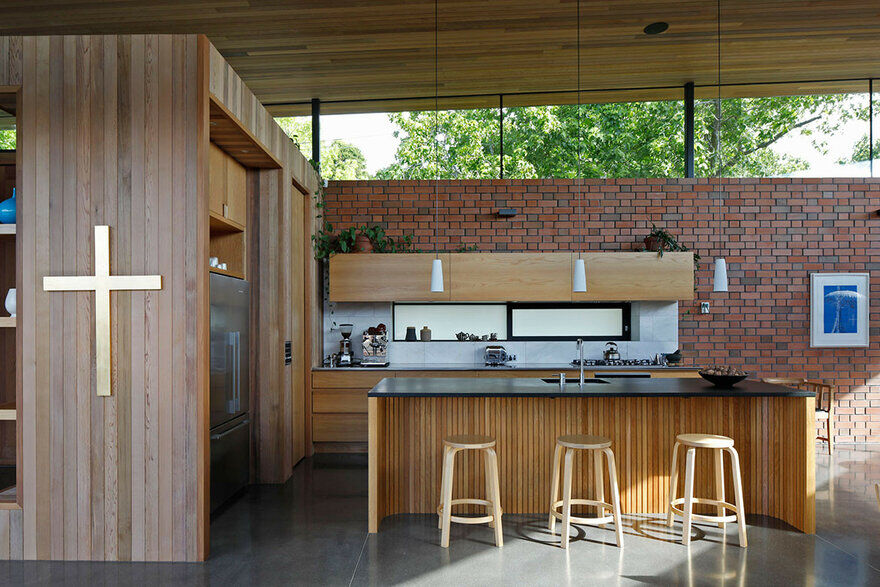 Walled Courtyard House Organised Around a Central Pool 4